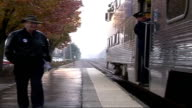 Amtrak train guard calls passengers aboard train Level crossing gate closes Trains passing each other on track