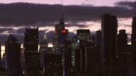 Midtown Manhattan at dawn.  The clouds are clearing their way for the sunrise.