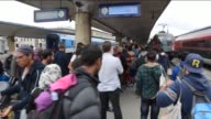 Migrants arrived in Vienna after leaving the transit zone of the Budapest main railway station Keleti en route to Germany on September 5 2015 A...