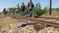 FOOTAGE Migrants cross the border from Serbia into Hungary on August 30 2015 in Roszke Hungary Last summer thousands of refugees and migrants were...