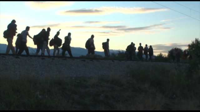 Migrants move within an area after Macedonian authorities allowed thousands of migrants to cross the border from Greece ceding to pressure that has...