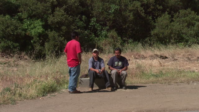 Migrants Wait For Work
