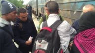 Migrants who have arrived from Greece attempt to board a train that is bound for the Serbian border on October 23 2015 in Gevgelija Macedonia Despite...