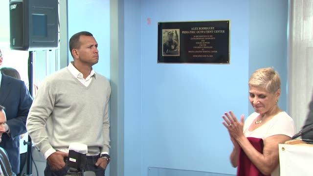 Miguel A Fuentes Jr reads plaque in honor of Alex Rodriguez at the BronxLebanon Hospital Center Dedication Ceremony to Alex Rodriguez at New York NY
