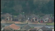 Mother due in court charged with his death Kirkcaldy of police cordon around house and officers searching in woodland AIR VIEW of police officers...
