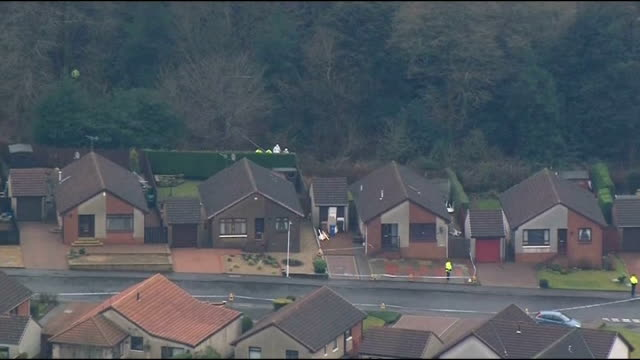 Mother due in court charged with his death AIR VIEW of street and house and police and forensic officers in woodland where body was found