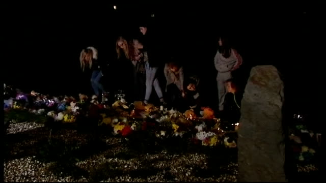 Mother due in court charged with his death SCOTLAND Edinburgh Back view child standing next to makeshift memorial to Mikaeel Kular Candles and soft...