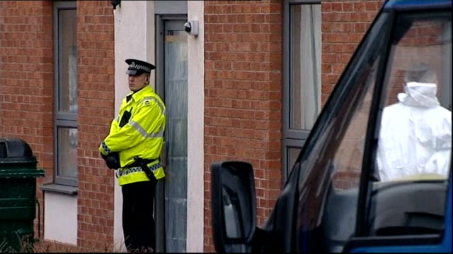 Mother due in court charged with his death SCOTLAND Edinburgh EXT Police officer standing guard outside flat as forensic officers along