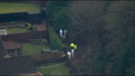 Mother due in court charged with his death SCOTLAND Kirkcaldy EXT Various AIR VIEWS of garden and police and forensic officers in woodland