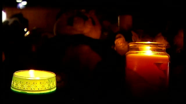 Mother due in court charged with his death Lit candles and cuddly toys