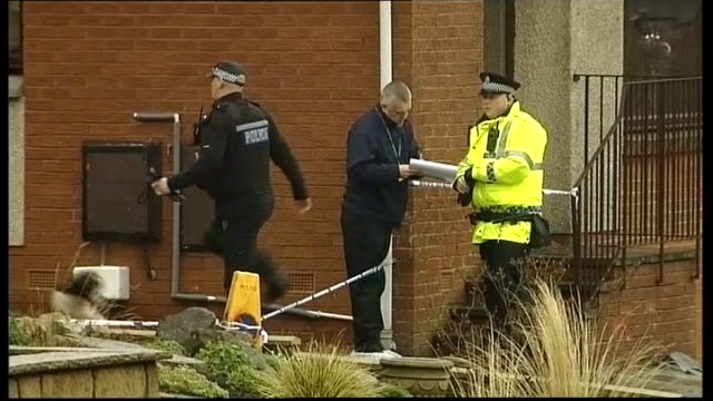 Mother due in court charged with his death Police officers and polic dog along by house Police officer standing next to tree in woodland