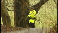 mother to appear in court LIB Police officer on duty in wooded area Police along road