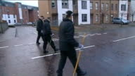 mother to appear in court LIB Police with sticks searching road near Mikaeel's home Police searching bushes Police officer on duty outside flats