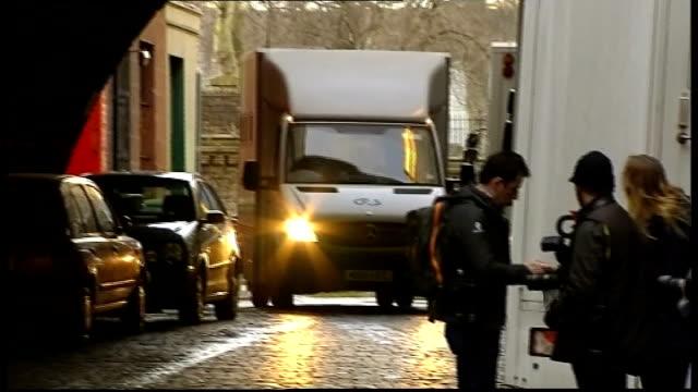 Prison van arrivals Smaller van along into garage / Larger G4S prison van along then surrounded by photographers then along into court through gates...