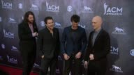 Mike Eli James Young Chris Thompson and Jon Jones at the 49th Annual Academy of Country Music Awards Arrivals at MGM Grand Garden Arena on April 06...