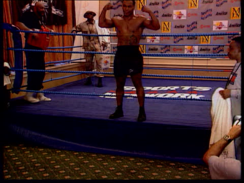 Mike Tyson allegedly assaults stripper LIB London Boxer Mike Tyson posing for photocall at edge of ring MSs Tyson sparring in ring