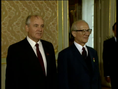 Mikhail Gorbachev walks down staircase to meet East German leader Erich Honecker and pose for photocall during 40th Anniversary ceremony / Gorbachev...