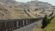 A mile long Burlington Northern Santa Fe 100 car coal train heads west from the Powder River Basin in Montana and Wyoming across the Bozeman Pass...