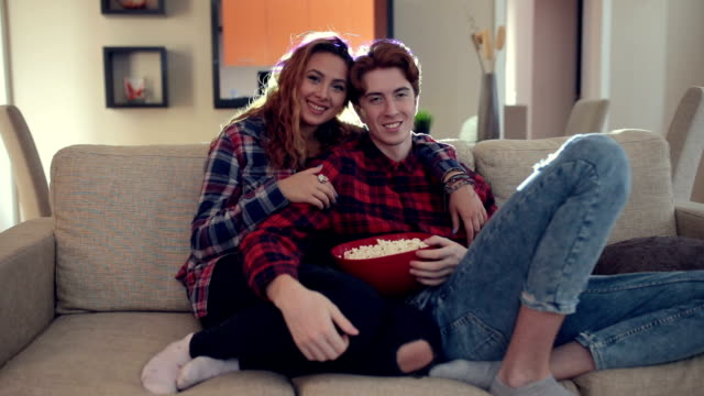 Milennials wathcing movie at home