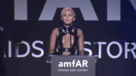 SPEECH Miley Cyrus at amfAR Inspiration Los Angeles 2014 in Los Angeles CA