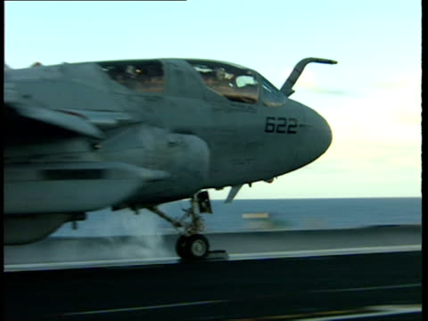 MS, TS, Military airplane taking off from deck of aircraft carrier