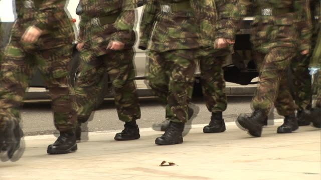 Military Army Soldiers / Troops marching in Camouflage outdoors