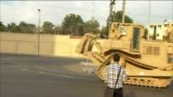 Military bulldozer knocks down barricades around proMorsi protest camp