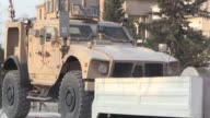 A military convoy carrying US made vehicles bulldozers and arms headed for Syrian Democratic Forces fighting in Raqa passes through the northeastern...