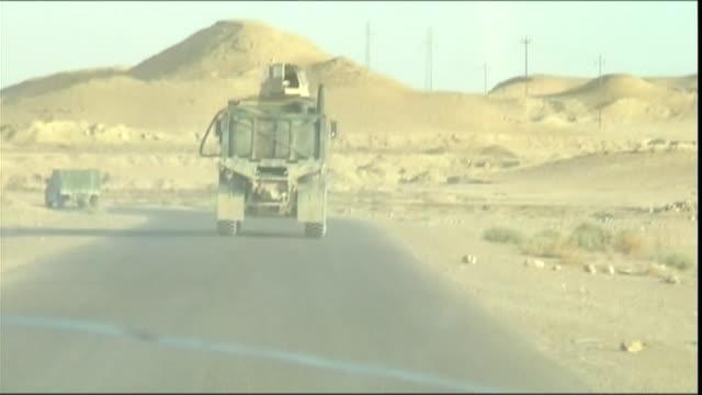 WS POV Military convoy driving towards Haditha dam, Haditha, Al Anbar, Iraq