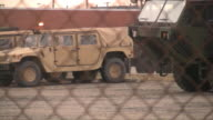 Military equipment. Army trucks and cars. Secured area.