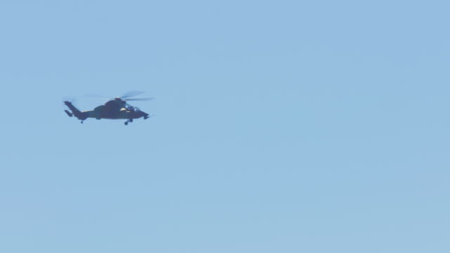 Military Eurocopter EC 665 moving on sky