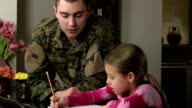 Military Father Helps Daughter with Homework