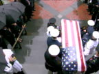 Military guards carry Senator Ted Kennedy's coffin out of church following funeral service 29 August 2009