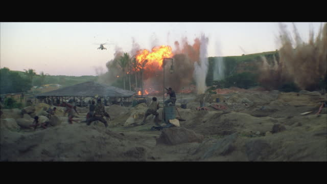 WS Military helicopter (MI-24) flying over mining camp explosion
