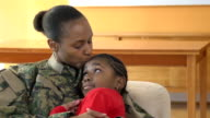 Military Mother Embraces and Kisses Her Daughter
