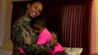 Military Mother Embraces her Daughter