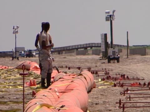 Military officers participate in clean up operation following major oild spill along the Gulf of Mexico