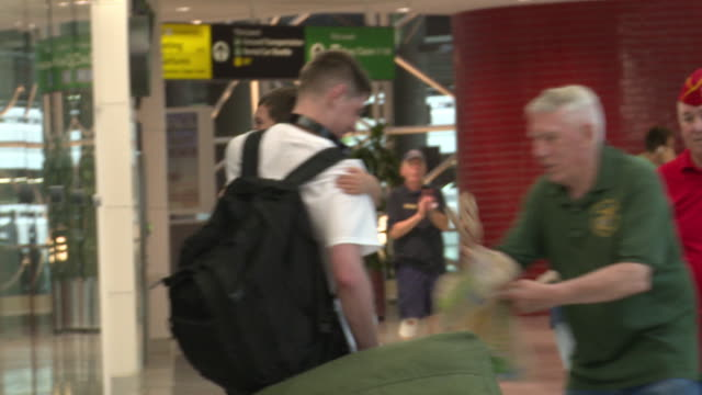 US Military Personnel and Contractors are Welcomed Home by Friends Family and other Veterans