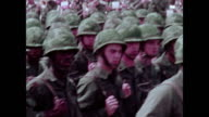/ military recruitment film soldiers in ceremonial parade on parade grounds carrying flags Vice President Spiro Agnew watching