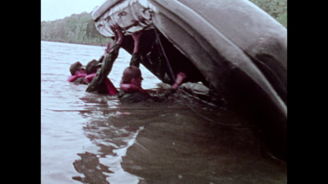 / military recruitment film soldiers in raft deliberately overturn then right the raft and get back in / montage of recreational activities...