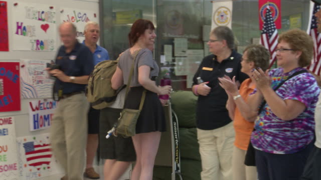 US Military Service Members and Contractors are Greeted at the Airport