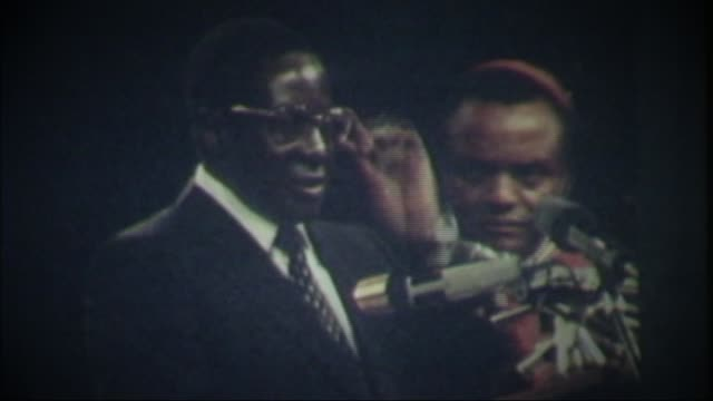 Robert Mugabe profile T18048015 / TX ZIMBABWE Harare Robert Mugabe swearing oath on independence of Zimbabwe SOT