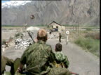 Military truck with troops atop negotiates military checkpoint during Tajikistan civil war Tajikistan 1992