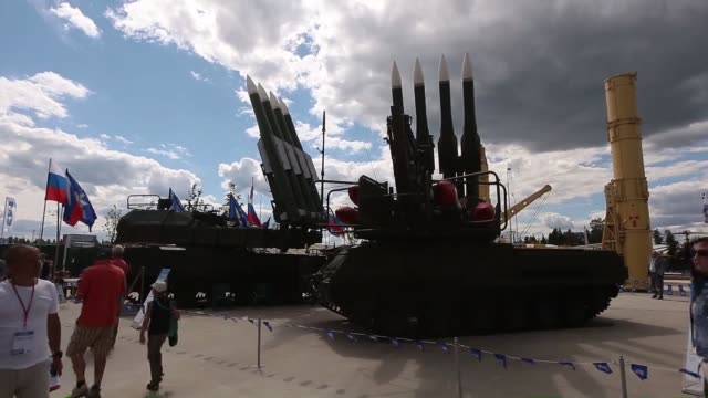 Military vehicles are on display during the international militarytechnical forum 'Army2015' at the new convention and exhibition center park...