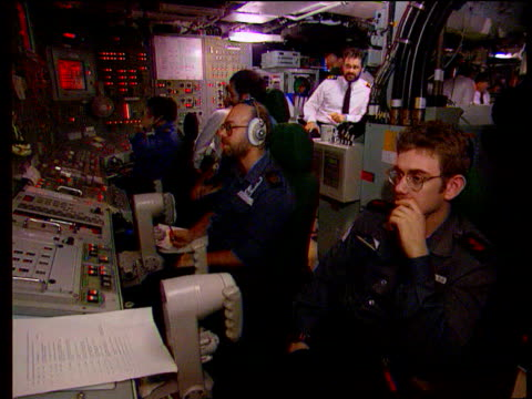 Millennium bug trident missiles fear LIB Trident submarine LIB Crew of submarine at controls Crew member filling out form Crew members at controls