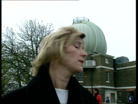 Millennium countdown All ITN copyright London Greenwich TMS crowd counting down SOT as balloons released TMS PAN along meridian line on ground TILT...