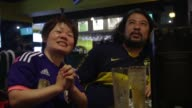 Millions of Japanese football fans watch helplessly as their womens teams is thrashed 52 by the United States in the womens World Cup