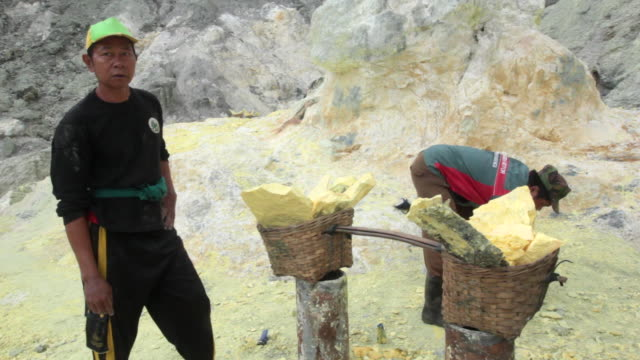 MS PAN Miner after collecting the sulfur at the Ijen volcano crater / Ijen, Java, Indonesia