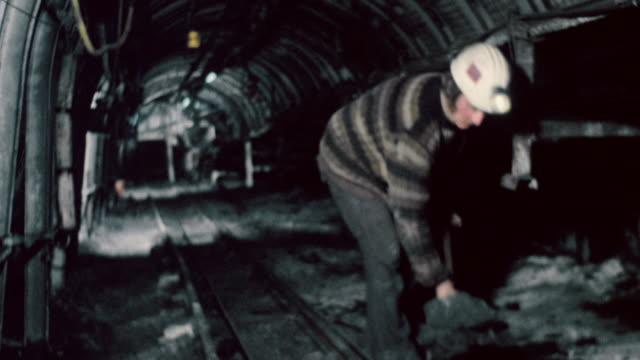 WS Miner shoveling coal spillage / England, United Kingdom