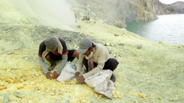 MS PAN Miners collecting sulfur rocks / Ijen, Java, Indonesia